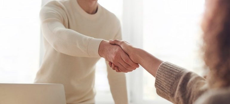 People shaking hands.